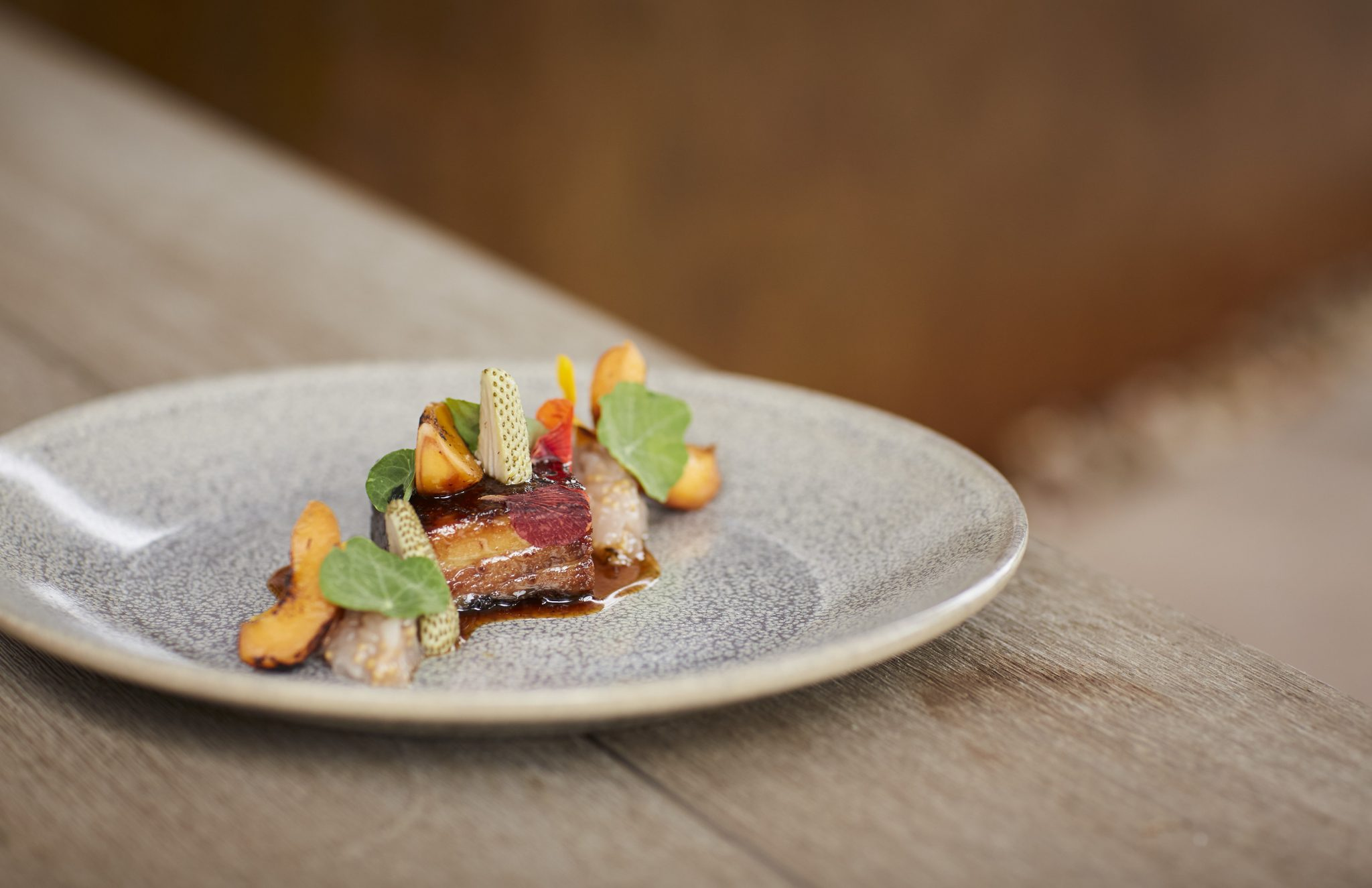 Braised Pork Belly with Roasted K&J Orchards Apricots, Pickled Green Strawberries and Nasturtium